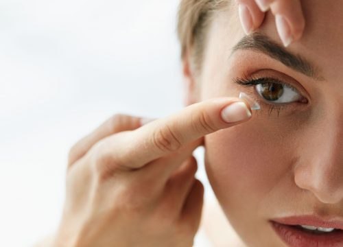 Woman about to put in a contact lens